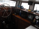 Pilot house with 5-drawer chart table, compass, chart-plotter, VHF and SSB radios, Radar, Depth-sounder, AIS reciever, etc.