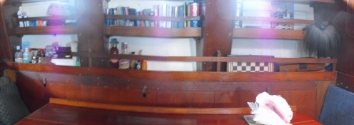 shelving on both port and starboard in saloon