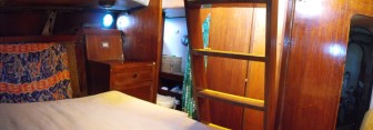 Master cabin with private head, ladder leading to stern deck