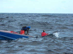 No they are not being swamped - these fishermen are just hiding behind the waves
