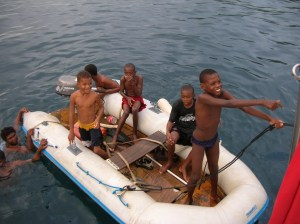 Caribbean boys clamor to come aboard